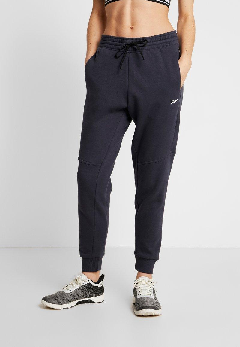 Reebok - LINEAR LOGO PANT - Teplákové kalhoty - dark blue