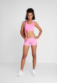 Reebok - CHASE BOOTIE SOLID - Leggings - pink - 1