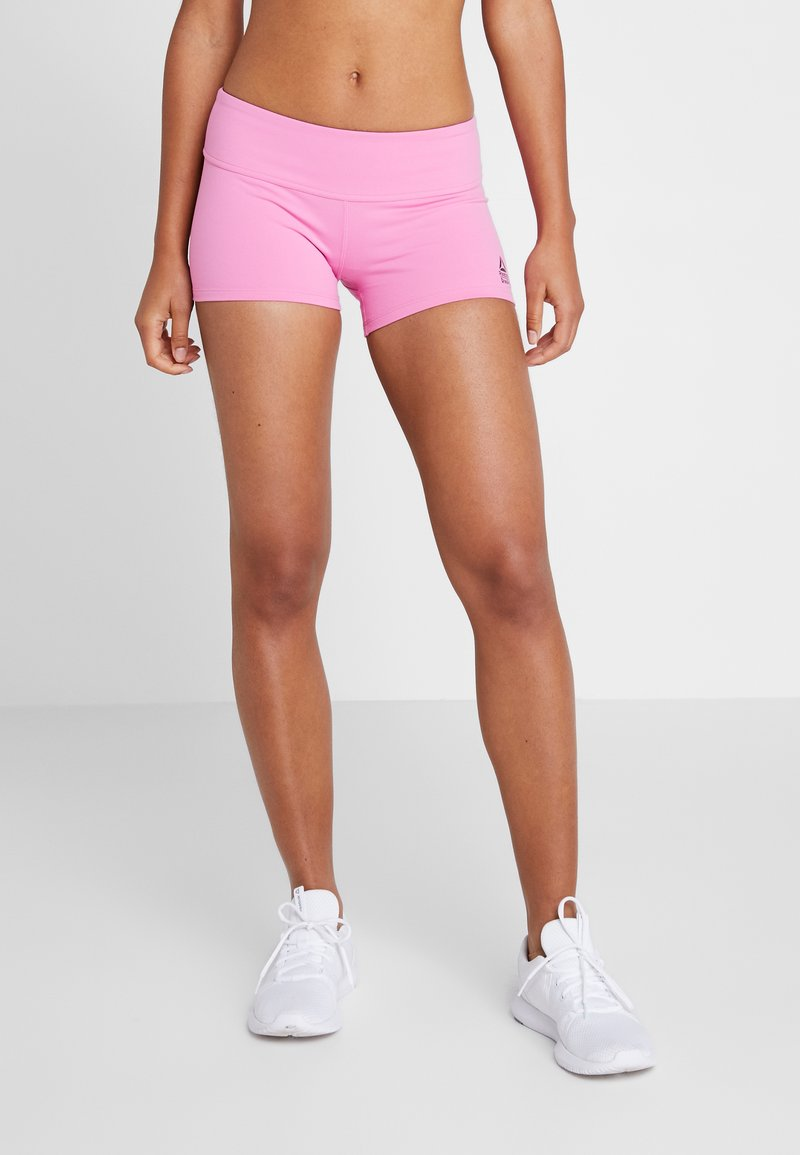 Reebok - CHASE BOOTIE SOLID - Tights - pink
