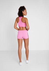 Reebok - CHASE BOOTIE SOLID - Leggings - pink - 2