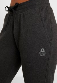Reebok - LIGHTWEIGHT JOGGER - Pantalon de survêtement - black melange - 4