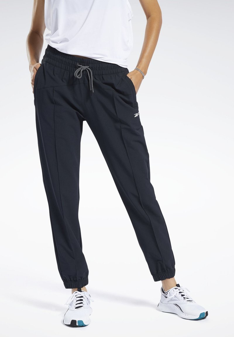 Reebok - COMMERCIAL WOVEN PANTS - Tracksuit bottoms - black