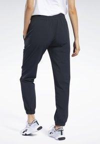 Reebok - COMMERCIAL WOVEN PANTS - Tracksuit bottoms - black - 2