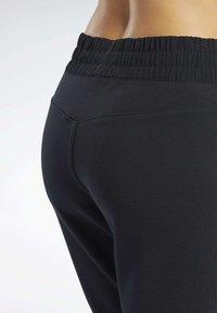 Reebok - QUIK COTTON PANTS - Spodnie treningowe - black - 5