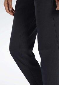 Reebok - QUIK COTTON PANTS - Spodnie treningowe - black - 3