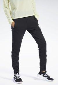 Reebok - QUIK COTTON PANTS - Spodnie treningowe - black - 0