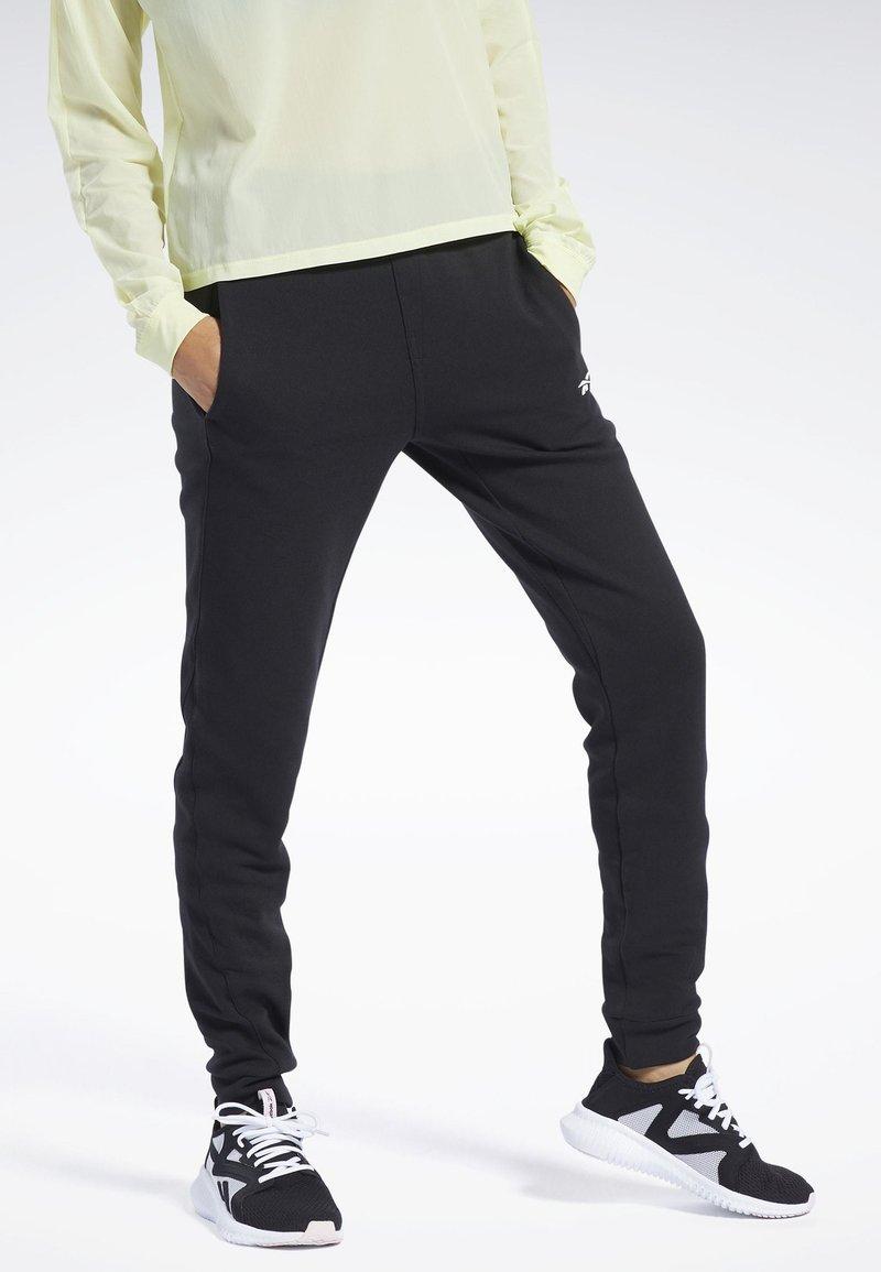 Reebok - QUIK COTTON PANTS - Spodnie treningowe - black