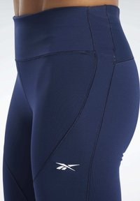 Reebok - UNITED BY FITNESS LUX PERFORM TIGHTS - Tights - blue