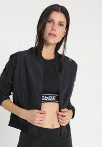 Reebok - Training jacket - black - 0