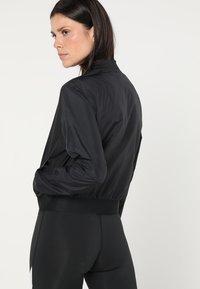 Reebok - Training jacket - black - 2