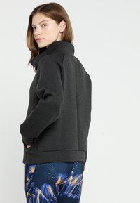 Reebok - COWL NECK - Sweatshirts - black