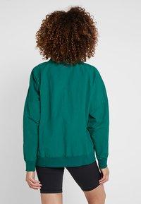 Reebok - T-shirt à manches longues - green - 2
