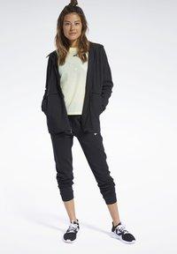 Reebok - QUIK COTTON HOODIE - veste en sweat zippée - black - 1