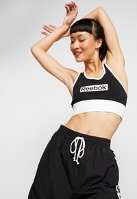 Reebok - LINEAR LOGO BRALETTE - Sports bra - black - 3