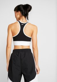 Reebok - LINEAR LOGO BRALETTE - Sports bra - black - 2