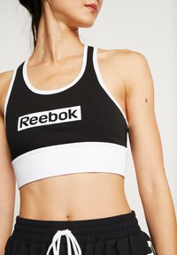 Reebok - LINEAR LOGO BRALETTE - Sports bra - black - 5