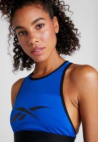 Reebok - WOR BRALETTE - Sports bra - blue - 4