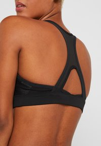 Reebok - HERO RACER BRA PAD - Sports bra - black