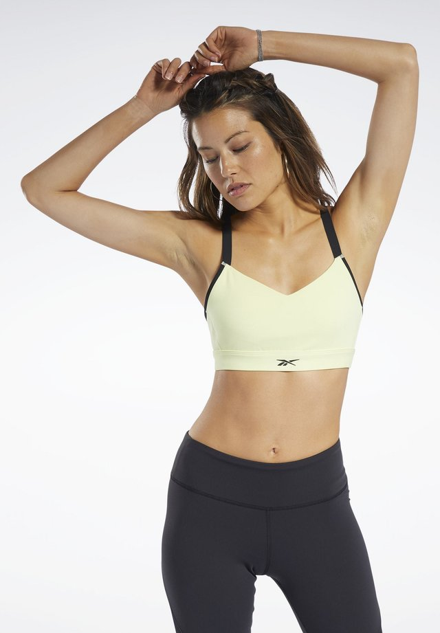 REEBOK HERO MEDIUM-IMPACT STRAPPY BRA - Sport BH - yellow