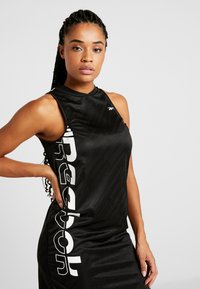 Reebok - WOR DRESS - Vestido de deporte - black - 3