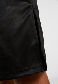 Reebok - WOR DRESS - Vestido de deporte - black - 5