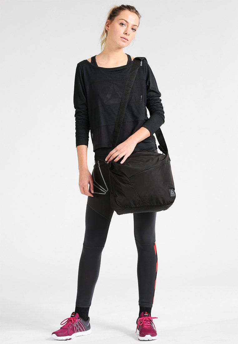 Reebok - FOUND SHOULDER BAG - Sports bag - black/medgre