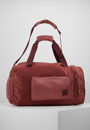 OST GRIP - Sports bag - rose dust