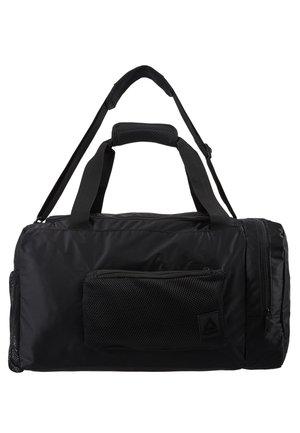 OST GRIP - Sports bag - black