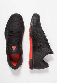 Reebok - SPEED TR FLEXWEAVE LOW PROFILE SHOES - Sports shoes - black/carotene - 1