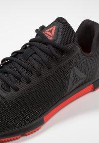 Reebok - SPEED TR FLEXWEAVE LOW PROFILE SHOES - Sports shoes - black/carotene - 5