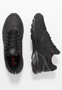 Reebok - RIDGERIDER TRAIL 4.0 - Løpesko for mark - black/grey/red - 1