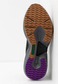 Reebok - SOLE FURY TRAIL - Běžecké boty do terénu - black/clover green /regal purple - 4