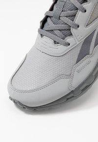 Reebok - RIDGERIDER 5.0 - Zapatillas de trail running - grey/vivid orange - 5