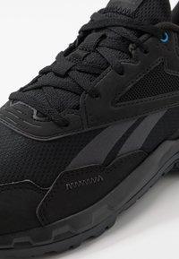 Reebok - RIDGERIDER 5.0 - Chaussures de running - black/grey/blue - 5