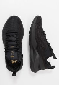 Reebok - SOLE FURY - Zapatillas de running neutras - black/gold - 1