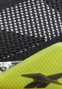 Reebok - FLASHFILM TRAINER SHOES - Zapatillas de running neutras - black - 9