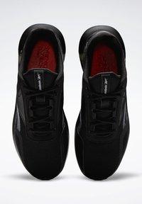 Reebok - REEBOK ENERGYLUX 2.0 SHOES - Neutral running shoes - black - 6