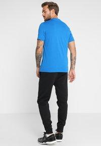 Reebok - TRAINING ESSENTIALS LINEAR LOGO - Sports shirt - blue - 2