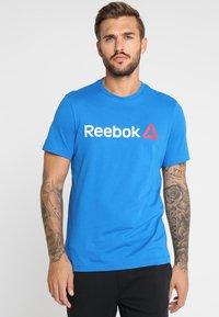 Reebok - TRAINING ESSENTIALS LINEAR LOGO - Sports shirt - blue - 0