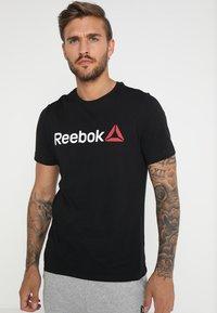 Reebok - TRAINING ESSENTIALS LINEAR LOGO - Koszulka sportowa - black - 0