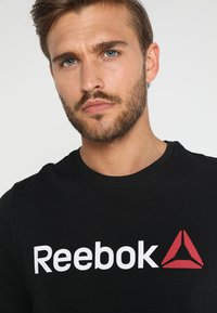 Reebok - TRAINING ESSENTIALS LINEAR LOGO - Koszulka sportowa - black - 3