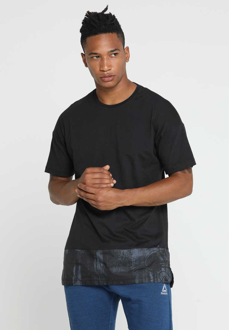 Reebok - TREND TEE - T-Shirt print - black