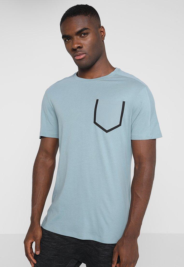 Reebok - MOVE TEE - Camiseta estampada - tealfo