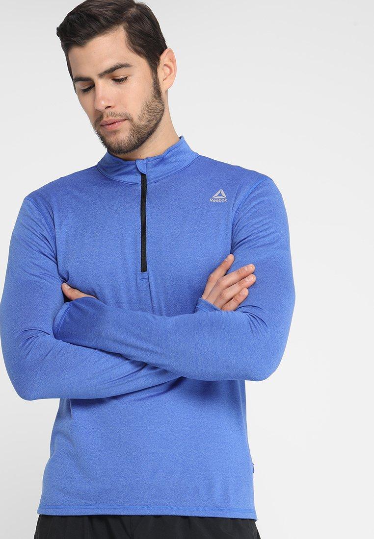 Reebok - QUARTER ZIP - Camiseta de deporte - crushed cobalt