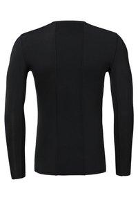 Reebok - COMPRESSION - T-shirt de sport - black - 1