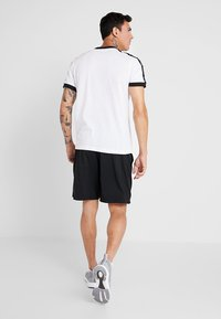 Reebok - GRAPHIC TEE - Print T-shirt - white - 2