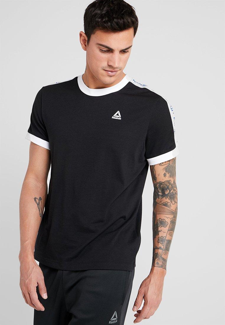 Reebok - GRAPHIC TEE - Camiseta estampada - black