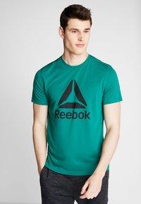 Reebok - WORKOUT READY - Koszulka sportowa - green - 0