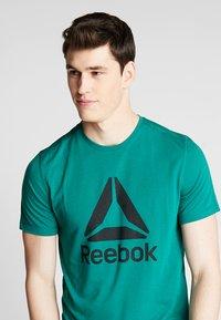 Reebok - WORKOUT READY - Koszulka sportowa - green - 3