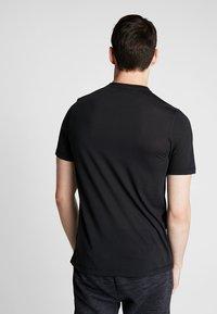 Reebok - WORKOUT READY - Camiseta de deporte - black - 2